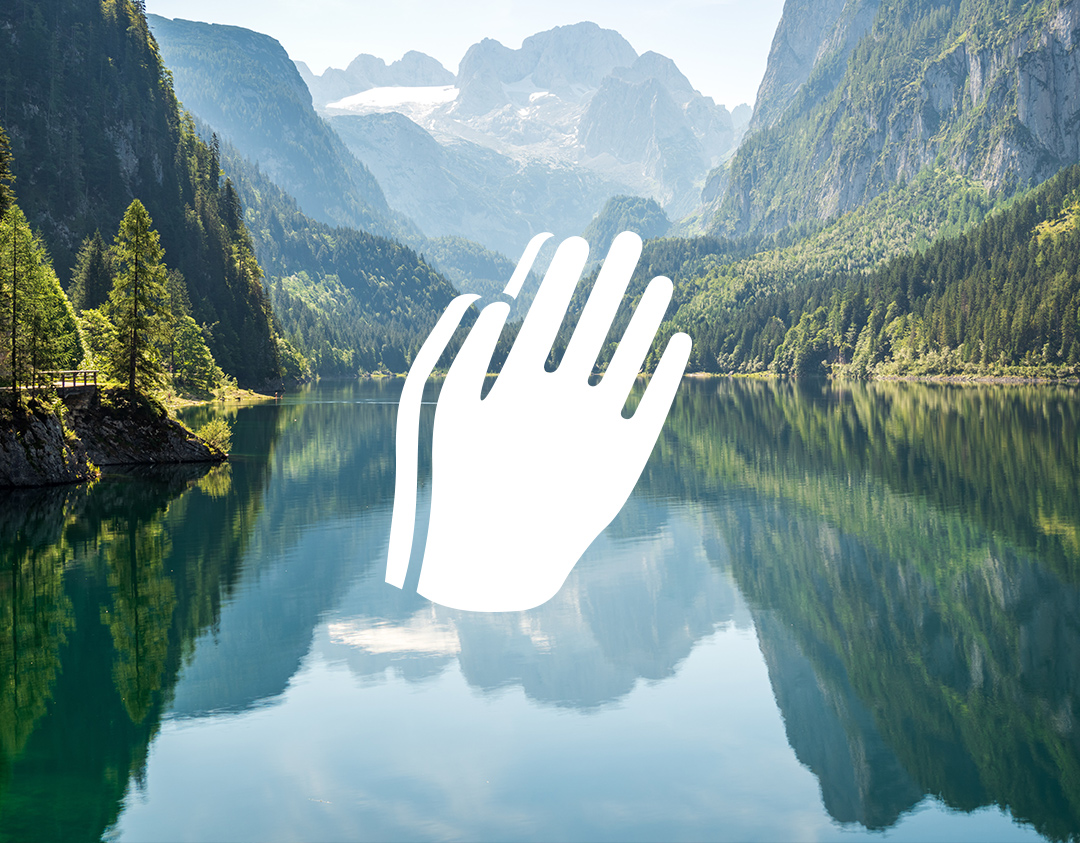 Mountain lake with praying hands icon