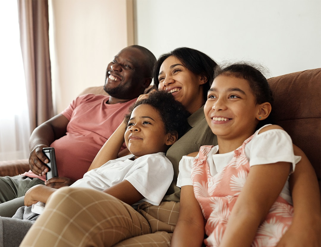 Family sitting on couch together